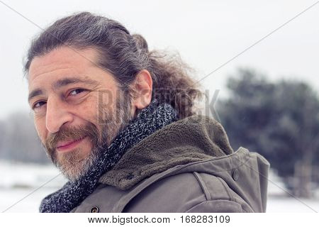 Portrait of a handsome unshaved middle aged man