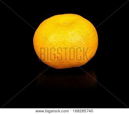 Fresh mandarin on black background