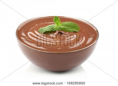Chocolate mousse with mint in dessert bowl on white background