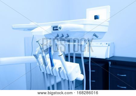 Special equipment in dental room of modern clinic