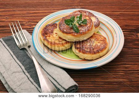 Beautiful golden cheese pancakes fried in a pan. Cottage cheese pancakes.