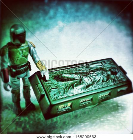 Vintage Kenner Boba Fett with Han Solo frozen in carbonite - recreation of a scene from Star Wars The Empire Strikes Back. Filtered image.
