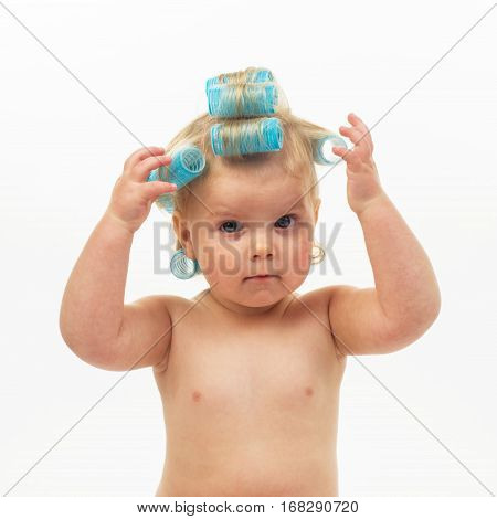 Cute little girl in hair curlers on a white background