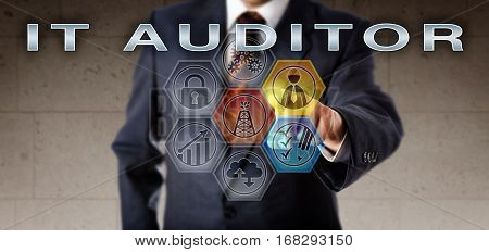Recruitment agent in blue business suit activating IT AUDITOR on an interactive virtual control screen. Information technology job concept relating to planning of audits in the oil and gas industry.