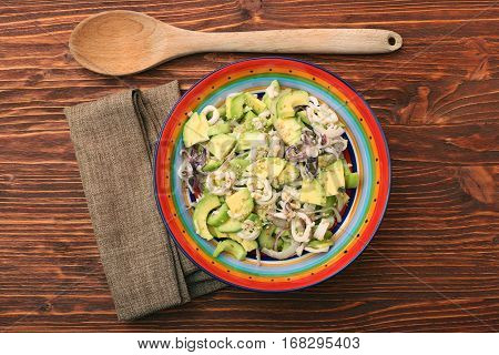 Avocado Salad with calamari and cucumber. Low calory healthy eating concept.