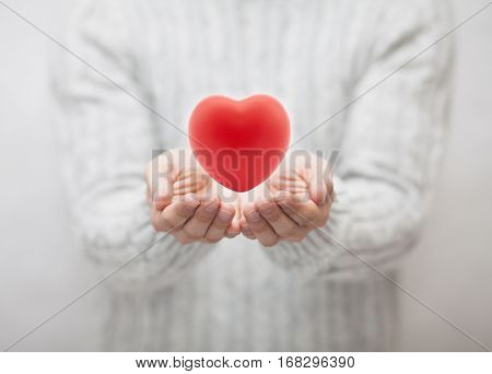 Man giving red heart. Love concept.