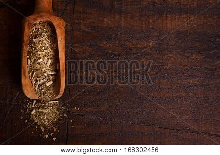 Mate With Scoop On Wooden Background