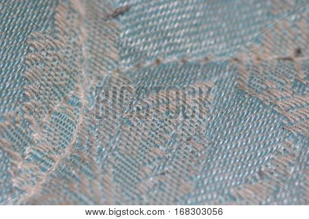 Close up of a blue mattress with stiches