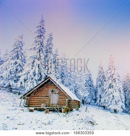 cabin in the mountains in winter, fabulous landscape