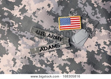 Military ID tags with USA flag on uniform background