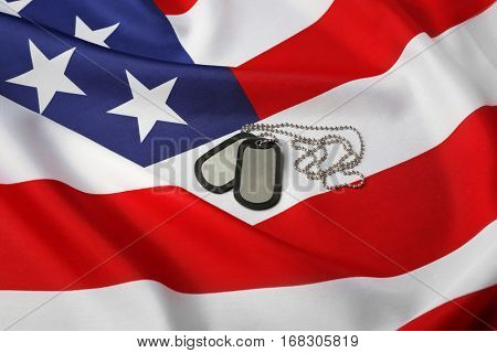 Military ID tags on USA flag background