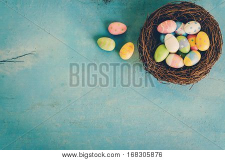 Colorful Easter Egg In The Nest On Blue Pastel Color Wood Background With Space.