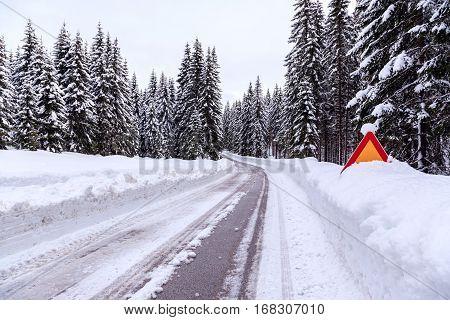 Snowy winter road in Julian Alps. Slovenia