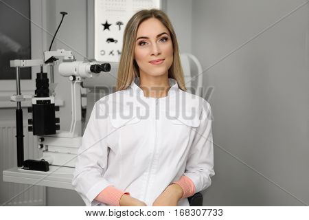 Beautiful young ophthalmologist in clinic