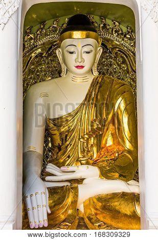 Buddha statues of the Shwedagon Pagoda at Yangon in Myanmar