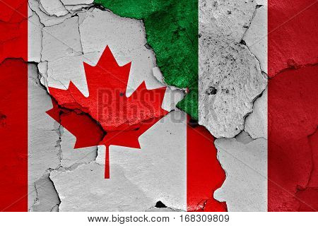 Flags Of Canada And Italy Painted On Cracked Wall