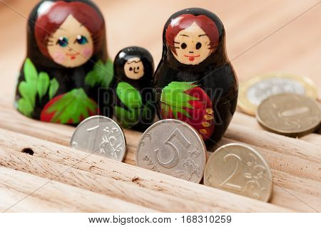 Russian coins and russian nesting doll, travelling concept
