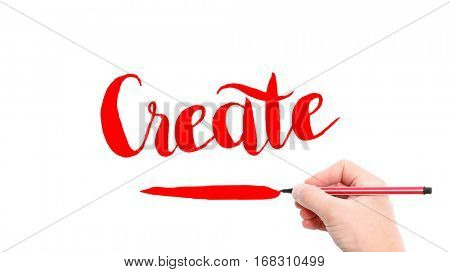 The verb Create written on a white background