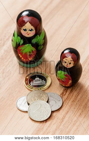 Russian coins and russian nesting doll, traveling  concept