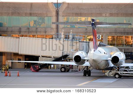 January 30, 2017 in Kansas City, MO:  Delta Airlines 717 aircraft parked at the gate ready for departure taken at Kansas City International Airport where passengers can fly on airlines to domestic and international destinations