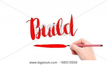 The verb Build written on a white background