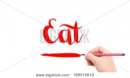 The verb Eat written on a white background
