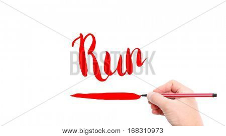 The verb run written on a white background