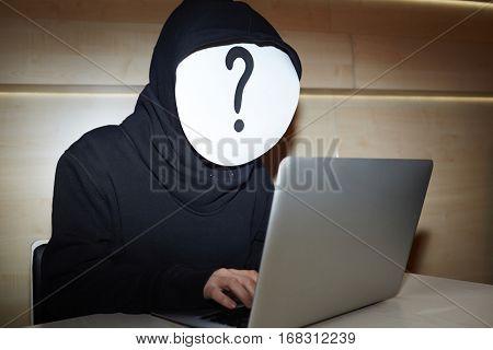 Hacker in black hoodie