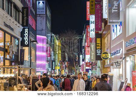 MYEONG-DONG SEOUL KOREA: APRIL 12016: People shopping and walking in Myeongdong street market at night Seoul South Korea