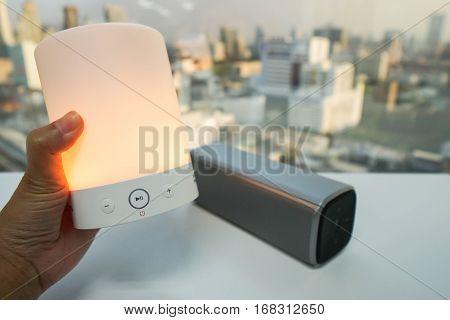 hold glow bluetooth wireless speaker in orange color