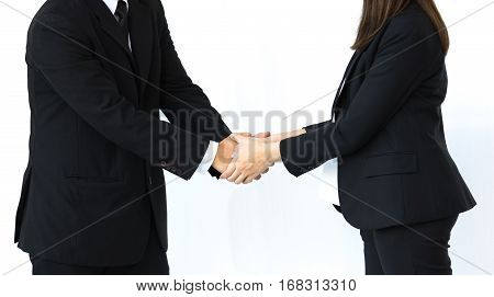 Handshake of business man and woman in strategic relationships on white background.