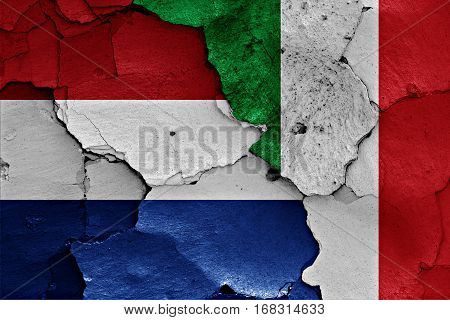 Flags Of Netherlands And Italy  Painted On Cracked Wall