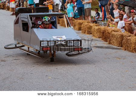 ATLANTA, GA - AUGUST 2016:  A kid steers a mockup of the Delorean from the