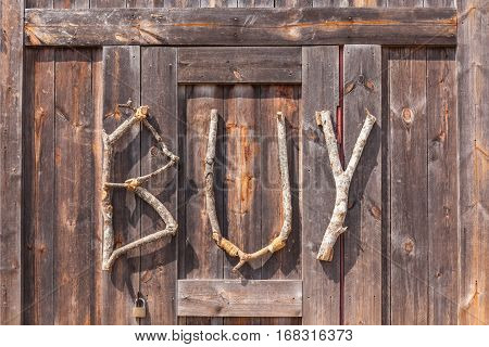 BUY wording made from natural wood on wooden background use for decoration on shop entrance in farmer market agriculture concept.
