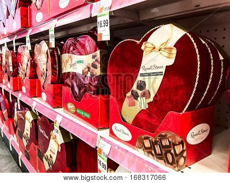 New York February 2 2017: Pharmacy shelves are filled with chocolates specially packaged in red heart shaped boxes during Valentine's Day shopping season.
