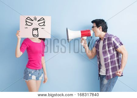 man take the microphone shout to woman take angrily billboard isolated on blue background