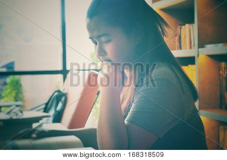 Woman sitting in a cafe and worried expression. Technical Writing light synthesizer. Business and Education Concept.