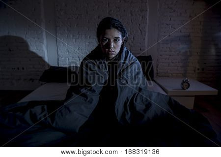young beautiful hispanic woman at home bedroom lying in bed late at night trying to sleep suffering insomnia sleeping disorder or scared on nightmares looking sad worried and stressed poster