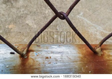 Close up of rusty steel wire mesh fence