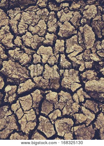 Drought,Dry soil, Cracked Ground texture background vintage tone