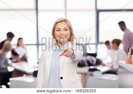 business, corporate and people concept - smiling businesswoman at office