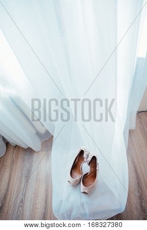 Elegant and stylish bridal shoes bride in the room