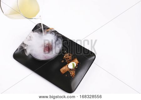 Molecular Cuisine, Delicious soup with beetroot - Stock image.