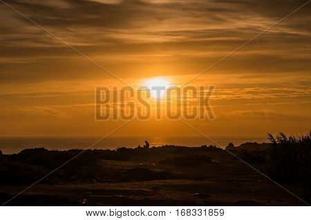 Portugal - Person Under Sunset