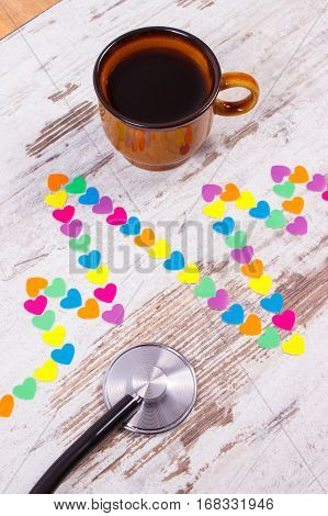 Cardiogram Line Of Paper Hearts, Stethoscope And Cup Of Coffee, Medicine And Healthcare Concept