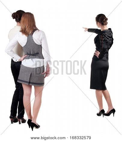 back view of three young business woman pointing. Team work. Rear view people collection.  backside view of person.  Isolated over white background.