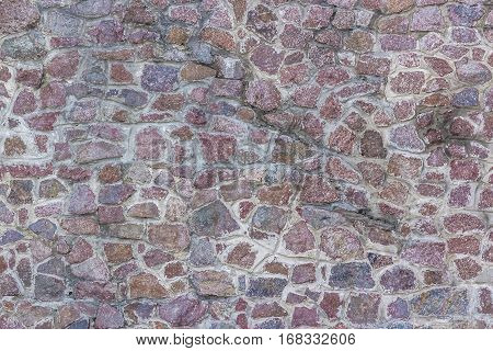 Background of stone wall texture photo. red and black