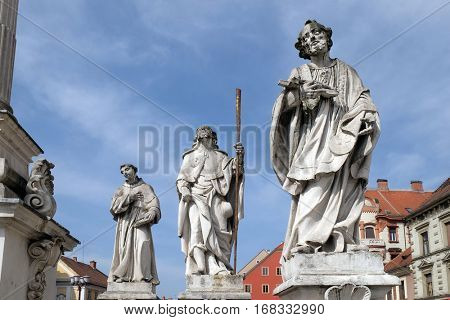 MARIBOR, SLOVENIA - APRIL 03: Saints Anthony of Padua, Roch and Francis Xavier statue, Plague column at Main Square of the city of Maribor in Slovenia, Historical religious sculpture, April 03, 2016.