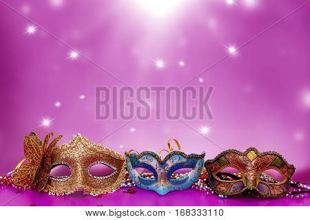 Traditional female carnival venetian mask  on table .Masquerade  mask on  glitter background.Mardi Gras