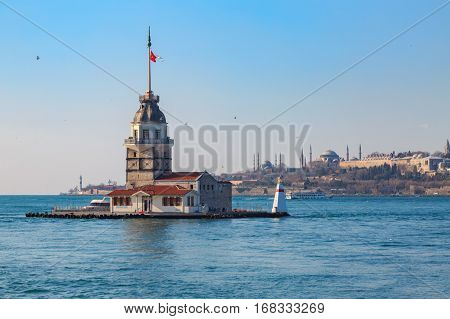 Maiden tower with old city istanbul background.